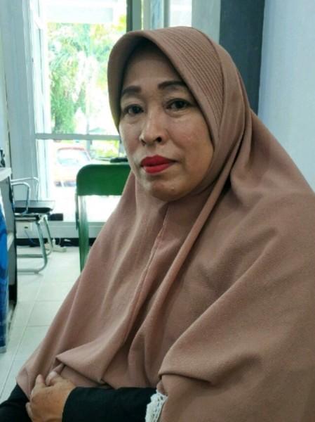 Ibu Rusidah saat berada di Kantor BPJS Kesehatan Cabang Palangka Raya belum lama ini.
