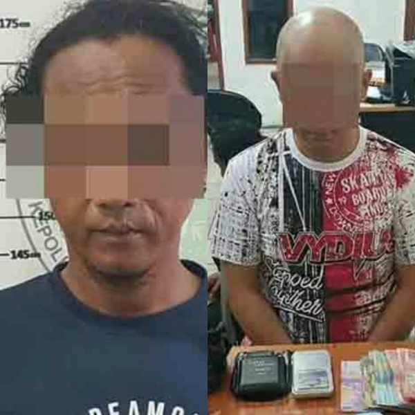 Kedua tersangka saat diamankan di Mapolres Kotim, Kamis (22/8/2019).
