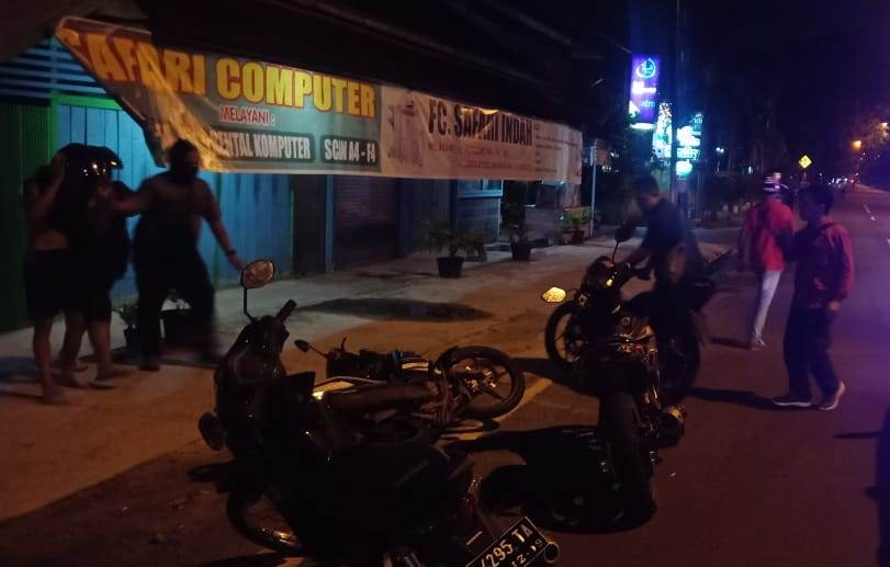 Petugas Satlantas Polresta Palangka Raya saat menyerap pelaku balapana liar Minggu (10/11/2019).