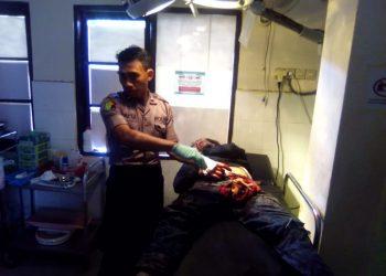 Korban saat mendapat perawatan usai mengalami luka bacok Selasa (10/12/2019) sore.
