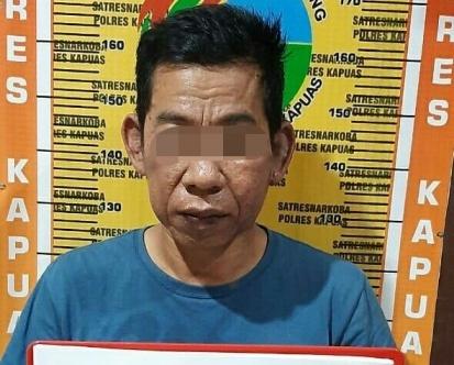 Pelaku saat diamankan di Mapolres Kapuas Kamis (13/2/2020).