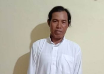 Pelaku saat diamankan di Mapolsek Kapuas Kuala.