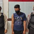 IST - Pelaku pencabulan istri orang, tertunduk lesu dihadapan polisi, Senin (25/1).